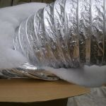 Звукопоглощающий (в развёрнутом виде). . На фото хорошо видна перфорация внутреннего воздуховода (АЛ). Теплоизоляция - синтепон.