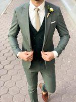 Зеленый мужской костюм-тройка