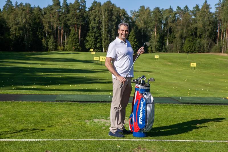 Генеральный директор Дмитрий Коробицын на турнире по гольфу.